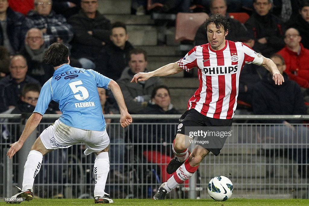 Niels Fleuren of VVV-Venlo (L), Mark van Bommel of PSV (R) during the Dutch Eredivisie match between PSV Eindhoven and VVV-Venlo at Philips Stadium on march 02, 2013 in Eindhoven, The Netherlands