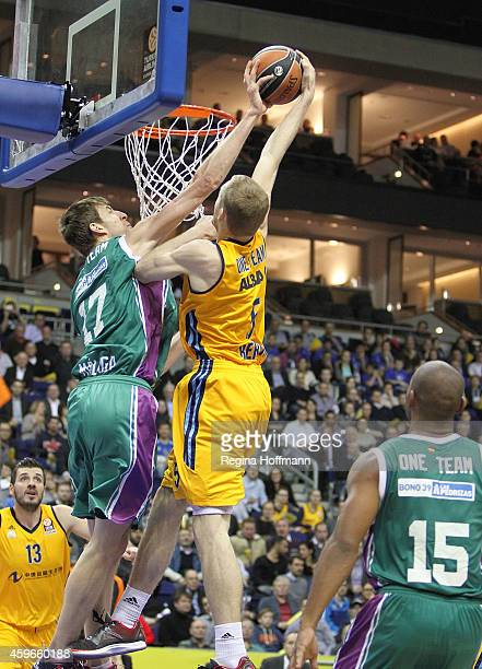 Niels Giffey #5 of Alba Berlin competes with Fran Vazquez #17 of Unicaja Malaga during the 20142015 Turkish Airlines Euroleague Basketball Regular...