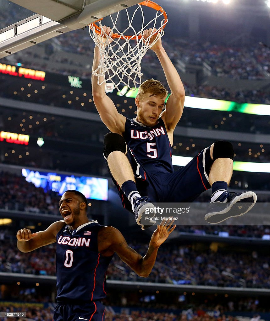 Niels Giffey #5 of the Connecticut Huskies dunks against the Florida Gators during the NCAA Men's Final Four Semifinal at AT&T Stadium on April 5, 2014 in Arlington, Texas.