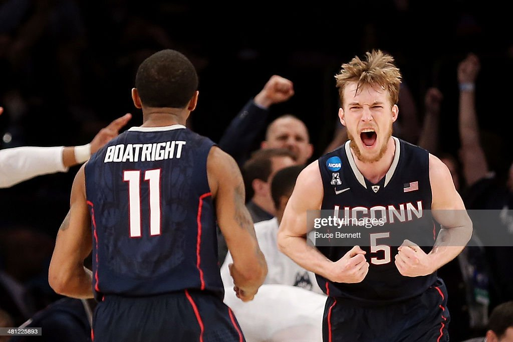 Niels Giffey #5 of the Connecticut Huskies reacts after hitting a basket as <a gi-track='captionPersonalityLinkClicked' href=/galleries/search?phrase=Ryan+Boatright&family=editorial&specificpeople=8698049 ng-click='$event.stopPropagation()'>Ryan Boatright</a> #11 looks on against Iowa State Cyclones during the regional semifinal of the 2014 NCAA Men's Basketball Tournament at Madison Square Garden on March 28, 2014 in New York City.