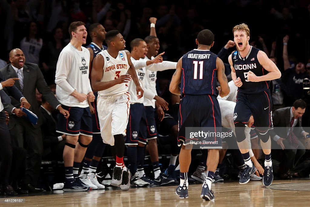 Niels Giffey #5 of the Connecticut Huskies reacts after hitting a basket as <a gi-track='captionPersonalityLinkClicked' href=/galleries/search?phrase=Ryan+Boatright&family=editorial&specificpeople=8698049 ng-click='$event.stopPropagation()'>Ryan Boatright</a> #11 and <a gi-track='captionPersonalityLinkClicked' href=/galleries/search?phrase=Melvin+Ejim&family=editorial&specificpeople=7493276 ng-click='$event.stopPropagation()'>Melvin Ejim</a> #3 of the Iowa State Cyclones look on against Iowa State Cyclones during the regional semifinal of the 2014 NCAA Men's Basketball Tournament at Madison Square Garden on March 28, 2014 in New York City.