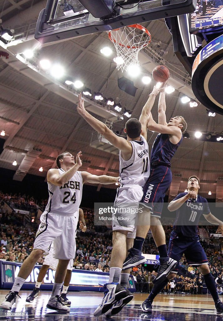 Niels Giffey #5 of the Connecticut Huskies shoots against Garrick Sherman #11 of the Notre Dame Fighting Irish at Purcel Pavilion on January 12, 2013 in South Bend, Indiana. Connecticut defeated Notre Dame 65-58.