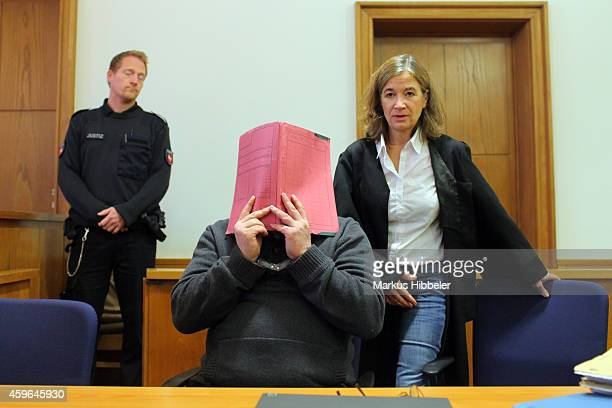 Niels H arrives for his trial at court on November 27 2014 in Oldenburg Germany Originally charged with the murder of several patients at a clinic in...
