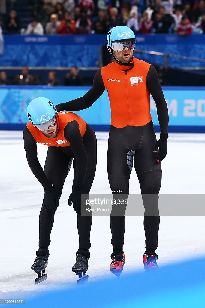 Niels Kerstholt consoles teammate Daan Breeuwsma of the Netherlands after in the Short Track Men's 5000m Relay on day fourteen of the 2014 Sochi...