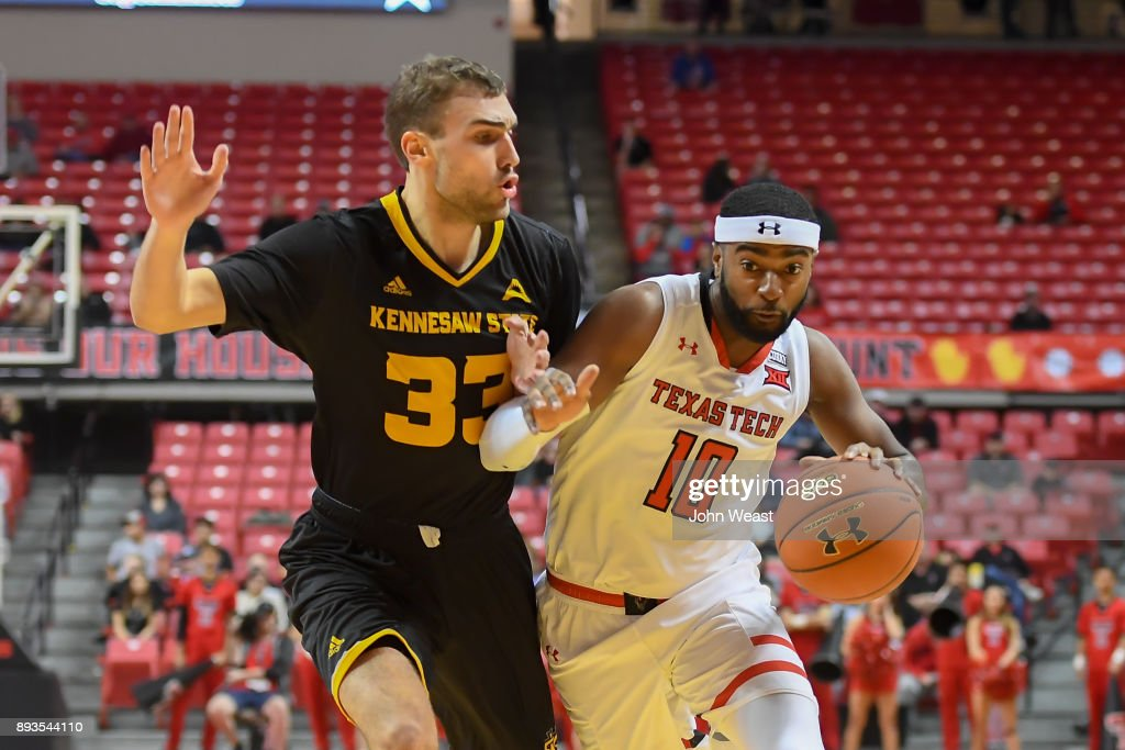 Niem Stevenson #10 of the Texas Tech Red Raiders drives to the basket against Kosta Jankovic #33 of the Kennesaw State Owls during the game on December 13, 2017 at United Supermarkets Arena in Lubbock, Texas. Texas Tech defeated Kennesaw State 82-53.