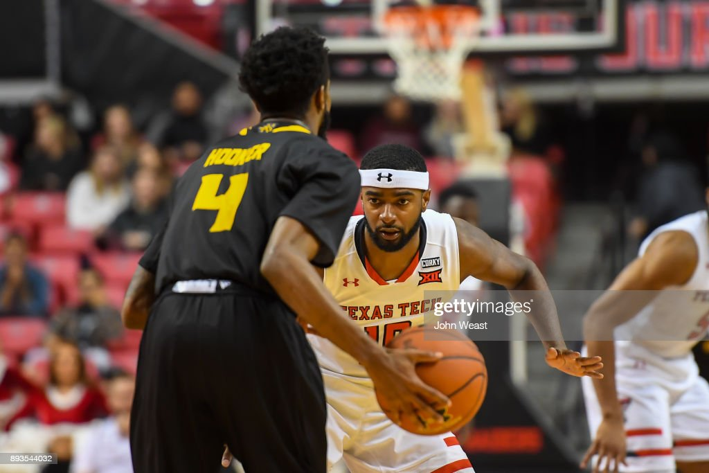 Niem Stevenson #10 of the Texas Tech Red Raiders guards Tyler Hooker #4 of the Kennesaw State Owls during the game on December 13, 2017 at United Supermarkets Arena in Lubbock, Texas. Texas Tech defeated Kennesaw State 82-53.