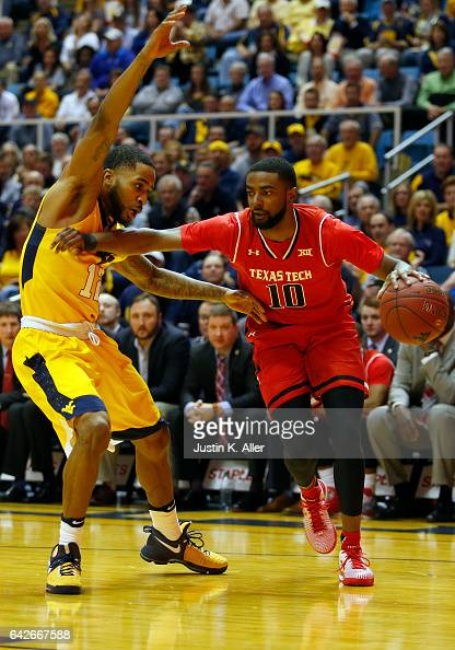 Niem Stevenson of the Texas Tech Red Raiders handles the ball against Tarik Phillip of the West Virginia Mountaineers at the WVU Coliseum on February...