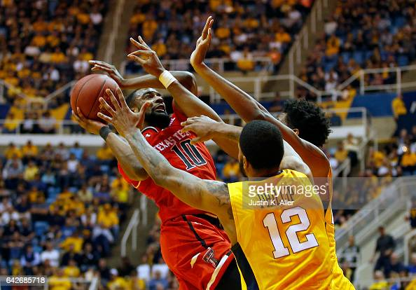 Niem Stevenson of the Texas Tech Red Raiders pulls up against Tarik Phillip of the West Virginia Mountaineers at the WVU Coliseum on February 18 2017...