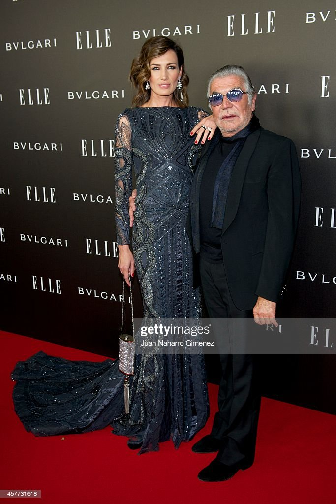 Nieves Alvarez (L) and Roberto Cavalli attend Elle Style Awards 2014 photocall at Italian Embassy on October 23, 2014 in Madrid, Spain.