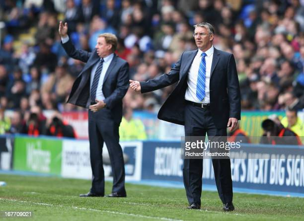 Nigel Adkins manager of Reading gives instructions with Harry Redknapp manager of Queens Park Rangers during the Barclays Premier League match...