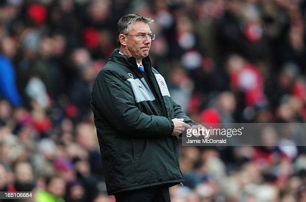 Nigel Adkins manager of Reading looks thoughtful during the Barclays Premier League match between Arsenal and Reading at Emirates Stadium on March 30...