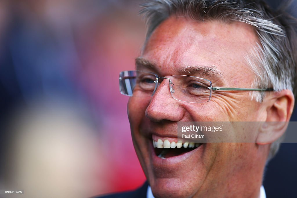 Nigel Adkins, manager of Reading smiles prior to the Barclays Premier League match between Fulham and Reading at Craven Cottage on May 4, 2013 in London, England.