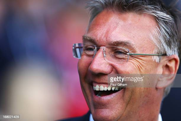 Nigel Adkins manager of Reading smiles prior to the Barclays Premier League match between Fulham and Reading at Craven Cottage on May 4 2013 in...