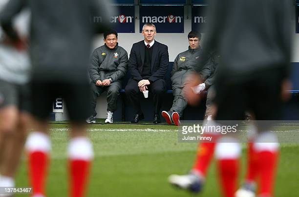Nigel Adkins manager of Southampton looks on before the FA Cup Fourth Round match between Millwall and Southampton at The Den on January 28 2012 in...