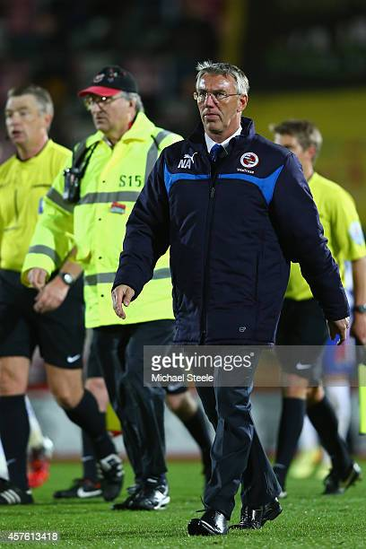 Nigel Adkins the manager of Reading heads to the dressing room after his teams 03 defeat during the Sky Bet Championship match between AFC...