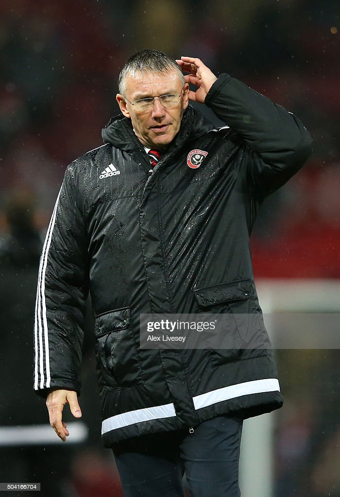 <a gi-track='captionPersonalityLinkClicked' href=/galleries/search?phrase=Nigel+Adkins&family=editorial&specificpeople=4015297 ng-click='$event.stopPropagation()'>Nigel Adkins</a>, the manager of Sheffield United looks dejected after the Emirates FA Cup Third Round match between Manchester United and Sheffield United at Old Trafford on January 9, 2016 in Manchester, England.