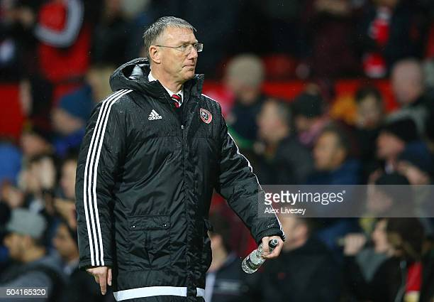 Nigel Adkins the manager of Sheffield United walks in at half time during the Emirates FA Cup Third Round match between Manchester United and...