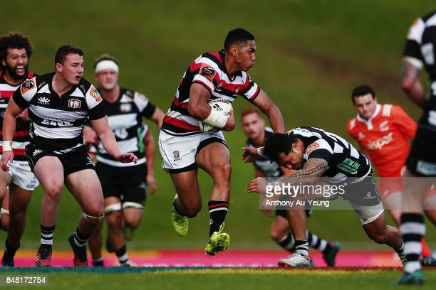 Nigel Ah Wong of Counties Manukau fends off a tackle during the round five Mitre 10 Cup match between Counties Manukau and Hawke's Bay at ECOLight...