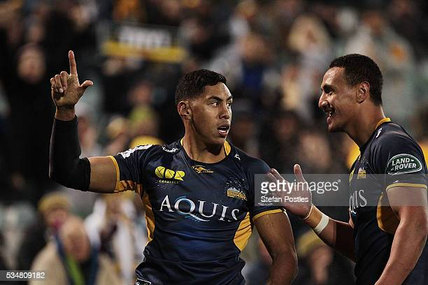 Nigel Ah Wong of the Brumbies celebrates after scoring a try during the round 14 Super Rugby match between the Brumbies and the Sunwolves at GIO...
