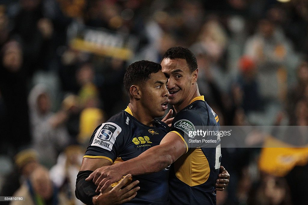 Nigel Ah Wong of the Brumbies is congratulated by Lausii Taliauli after scoring a try during the round 14 Super Rugby match between the Brumbies and the Sunwolves at GIO Stadium on May 28, 2016 in Canberra, Australia.