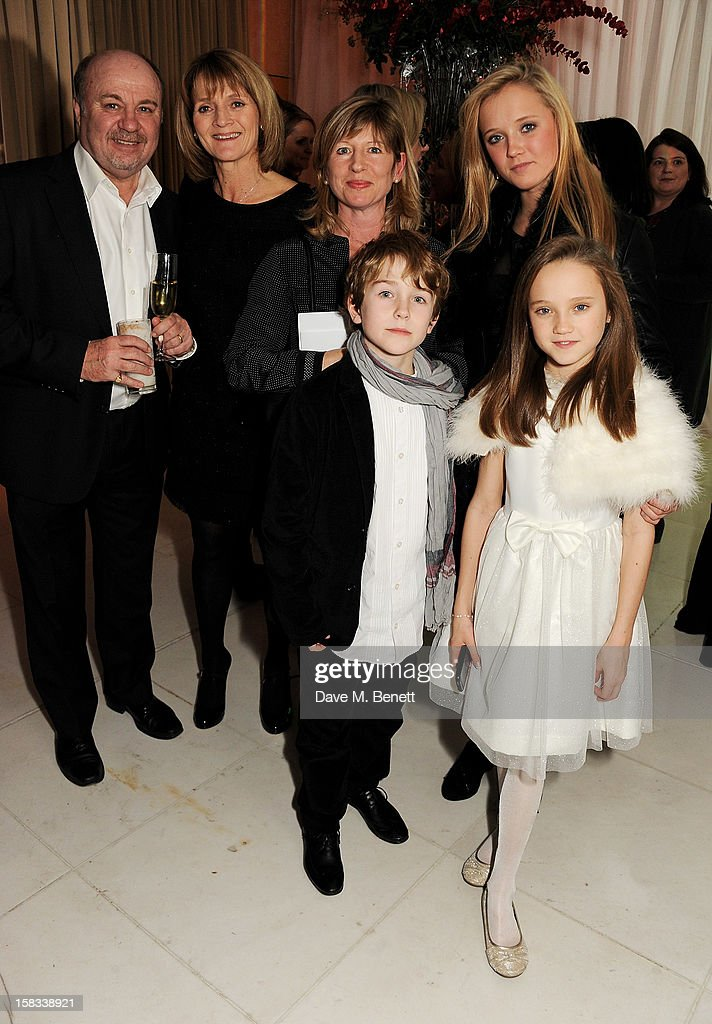 Nigel Allen, Elaine Allen, guest, Amelia Allen and (front) Samuel Joslin and Isabelle Allen attend the English National Ballet Christmas Party at St Martins Lane Hotel on December 13, 2012 in London, England.