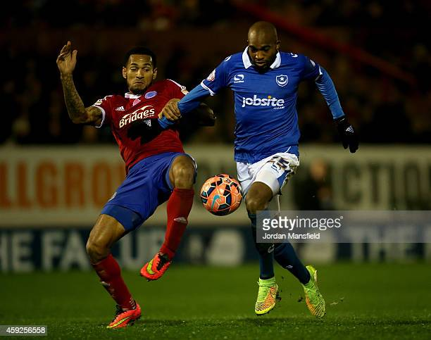 Nigel Atangana of Portsmouth battles for the ball with Jordan Roberts of Aldershot during the FA Cup First Round Replay match between Aldershot Town...