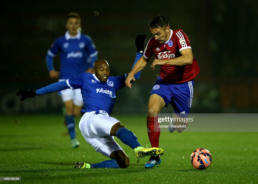 Nigel Atangana of Portsmouth tackles Brett Williams of Aldershot during the FA Cup First Round Replay match between Aldershot Town and Portsmouth at...