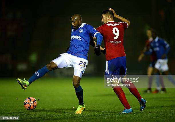 Nigel Atangana of Portsmouth tackles with Brett Williams of Aldershot during the FA Cup First Round Replay match between Aldershot Town and...