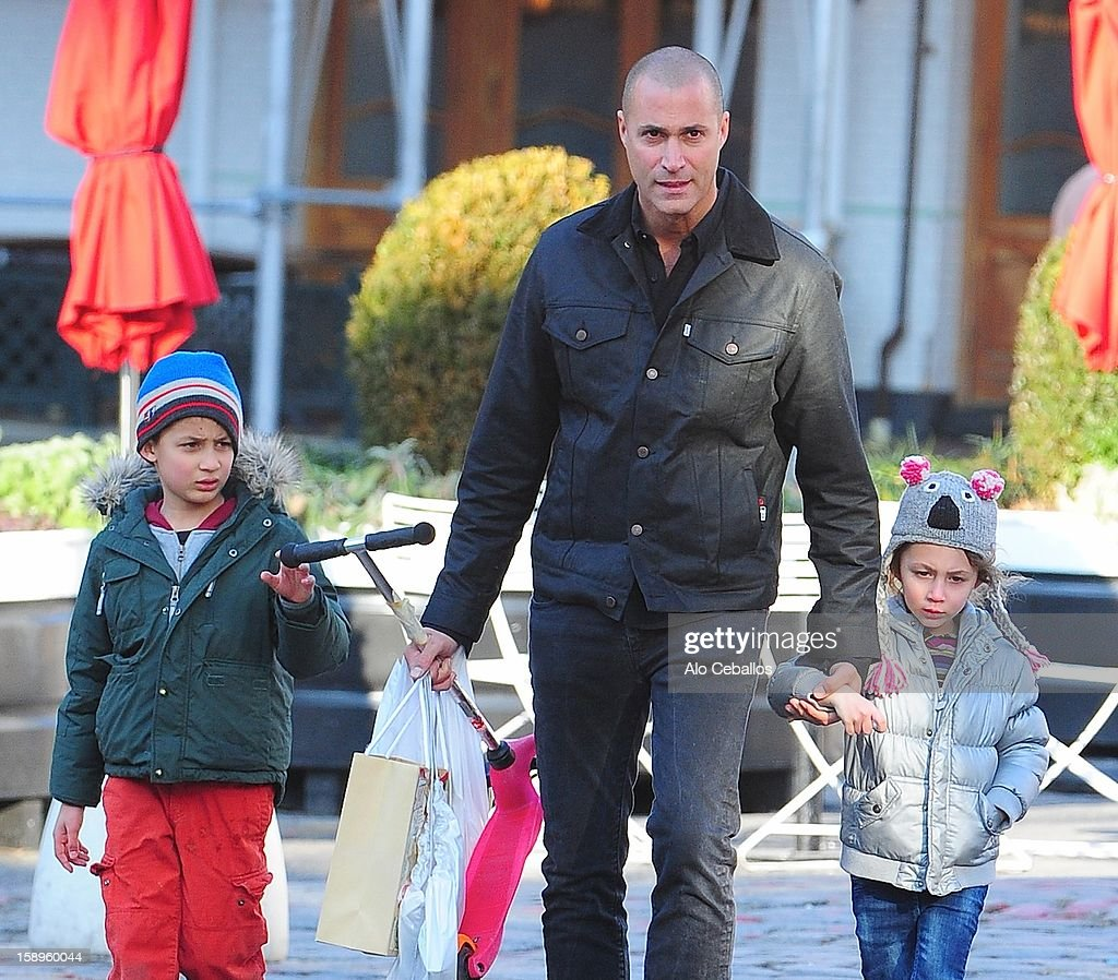 <a gi-track='captionPersonalityLinkClicked' href=/galleries/search?phrase=Nigel+Barker&family=editorial&specificpeople=691819 ng-click='$event.stopPropagation()'>Nigel Barker</a>, Jack Barker and Jasmine Barker are seen in the Meat Packing District on January 4, 2013 in New York City.