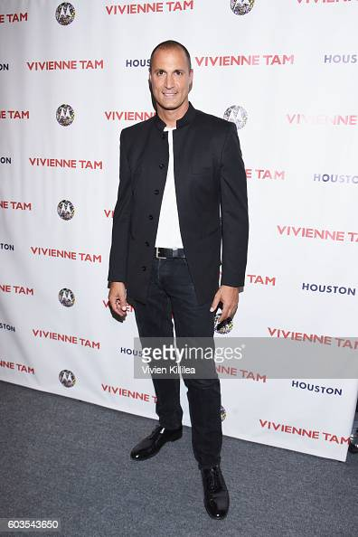 Nigel Barker poses backstage at the Vivienne Tam fashion show during New York Fashion Week The Shows at The Arc Skylight at Moynihan Station on...