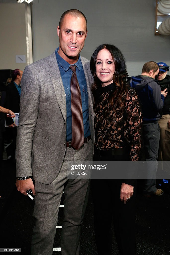 Nigel Barker poses with designer Jill Stuart backstage at the Jill Stuart Fall 2013 fashion show during Mercedes-Benz Fashion Week at The Stage at Lincoln Center on February 9, 2013 in New York City.