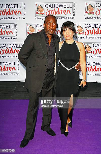 Nigel Benn and guest arrive for the Caudwell Children 'The Legends Ball' at Battersea Evolution on May 8 2008 in London England