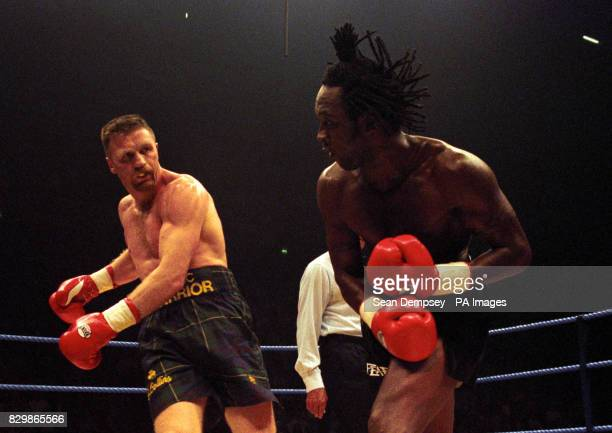 Nigel Benn ducks a punch from Steve Collins at the Manchester Nynex for there WBO world title fight Collins retained his title after Benn twisted his...