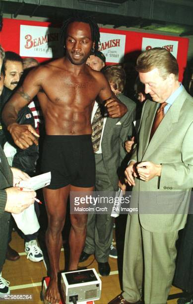 Nigel Benn who challenges for Steve Collins WBO Super Middleweight crown tomorrow is weighedin under the watchful eye of his manager Frank Warren in...