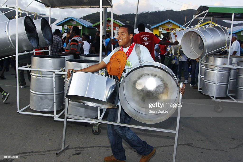 Nigel Bernard of the Melodians Steel Orchestra carries his steelpans in the Queen's Park Savannah at the Panorama semifinals on Sunday February 20...