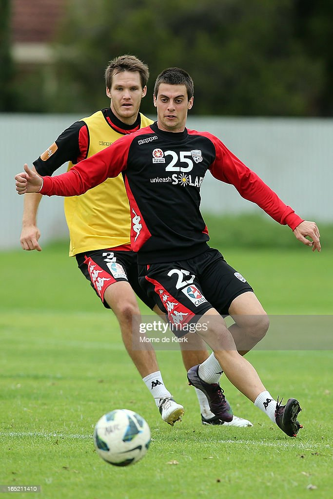 Nigel Boogaard and Tomi Juric compete for the ball during an Adelaide United A-League training session at the South Australian Sports Institute on April 2, 2013 in Adelaide, Australia.