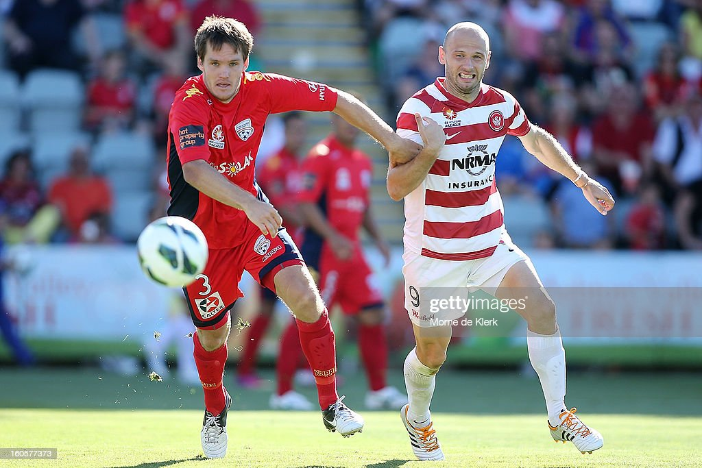 Nigel Boogaard of Adelaide competes with Dino Kresinger of Western Sydney during the round 19 A-League match between Adelaide United and the Western Sydney Wanderers at Hindmarsh Stadium on February 3, 2013 in Adelaide, Australia.