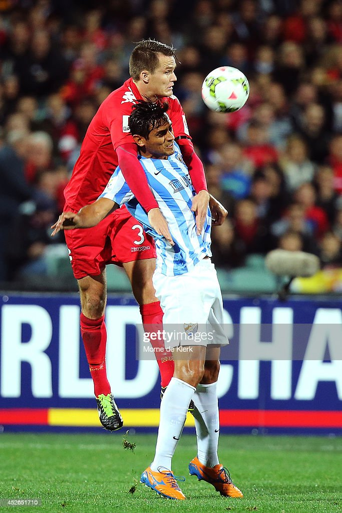 Nigel Boogaard of Adelaide competes with Roque Santa Cruz of Malaga during the international club friendly match between Adelaide United and Malaga...