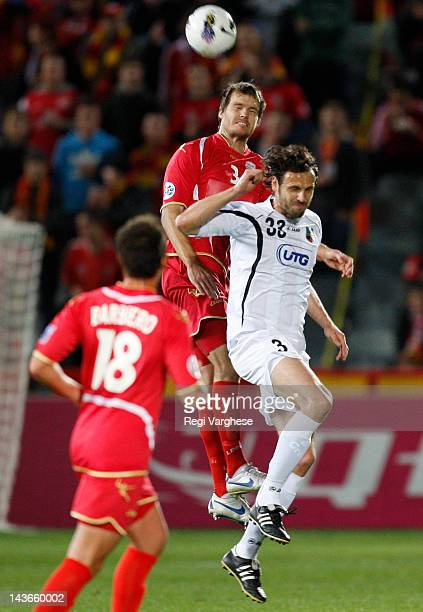 Nigel Boogaard of Adelaide United and Jan Kozak of Bunyodkor fight for the ball during the AFC Asian Champions League match between Adelaide United...