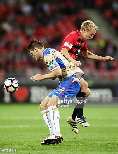 Nigel Boogaard of the Jets competes for the ball against Mitch Nichols of the Wanderers during the round three ALeague match between the Western...