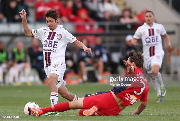 Nigel Boogaard of United gives away a penalty kick after this tackle on Daniel De Silva during the round one ALeague match between Perth Glory and...