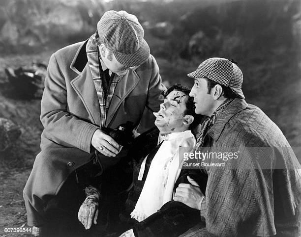 Nigel Bruce Richard Greene and Basil Rathbone on the set of 'The Hound of Bakersville'