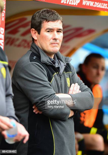 Nigel Clough Manager of Burton Albion stands in the dug out during the Sky Bet Championship match between Huddersfield Town and Burton Albion at the...