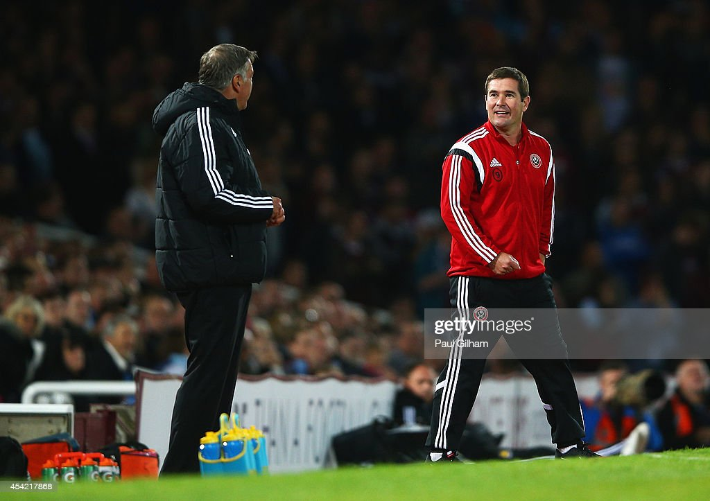 <a gi-track='captionPersonalityLinkClicked' href=/galleries/search?phrase=Nigel+Clough&family=editorial&specificpeople=901071 ng-click='$event.stopPropagation()'>Nigel Clough</a>, manager of Sheffield United talks to <a gi-track='captionPersonalityLinkClicked' href=/galleries/search?phrase=Sam+Allardyce&family=editorial&specificpeople=214691 ng-click='$event.stopPropagation()'>Sam Allardyce</a>, manager of West Ham United during the Capital One Cup Second Round match between West Ham United and Sheffield United at Boleyn Ground on August 26, 2014 in London, England.