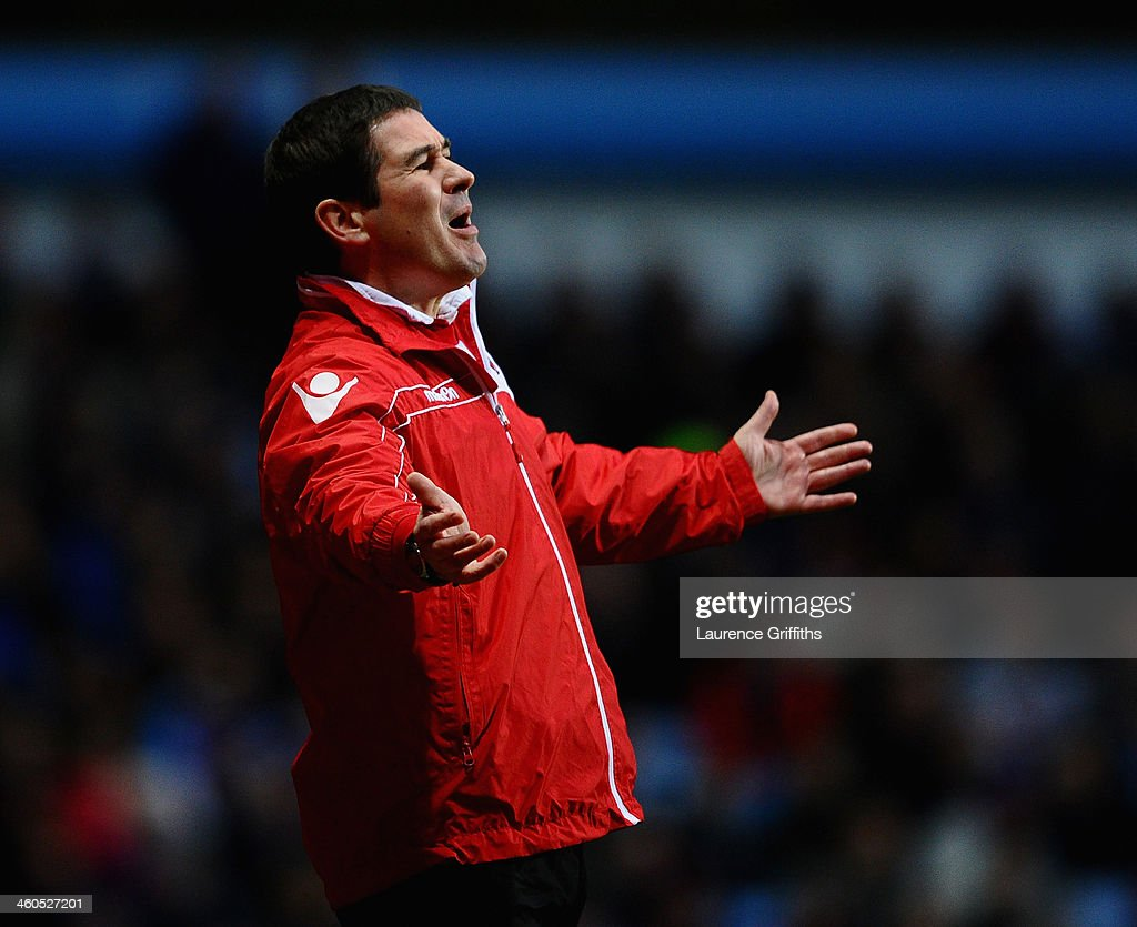 <a gi-track='captionPersonalityLinkClicked' href=/galleries/search?phrase=Nigel+Clough&family=editorial&specificpeople=901071 ng-click='$event.stopPropagation()'>Nigel Clough</a> of Sheffield United looks on during the Budweiser FA Cup Third Round match between Aston Villa and Sheffield United at Villa Park on January 4, 2014 in Birmingham, England.