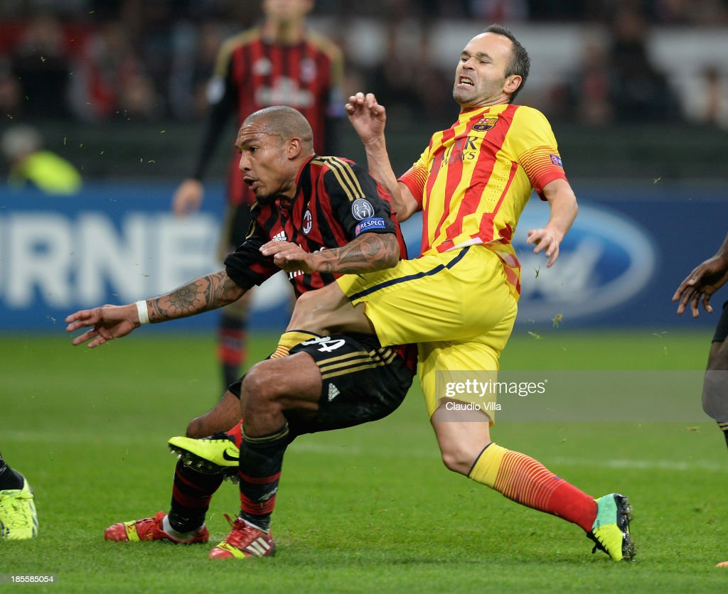 Nigel de Jong of AC Milan and <a gi-track='captionPersonalityLinkClicked' href=/galleries/search?phrase=Andres+Iniesta&family=editorial&specificpeople=465707 ng-click='$event.stopPropagation()'>Andres Iniesta</a> of FC Barcelona (R) .during the UEFA Champions League Group H match between AC Milan and Barcelona at Stadio Giuseppe Meazza on October 22, 2013 in Milan, Italy.