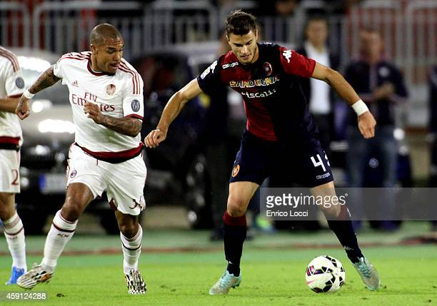 Nigel de Jong of AC Milan and Lorenzo Crisetig of Cagliari in action during the Serie A match between Cagliari Calcio and AC Milan at Stadio...
