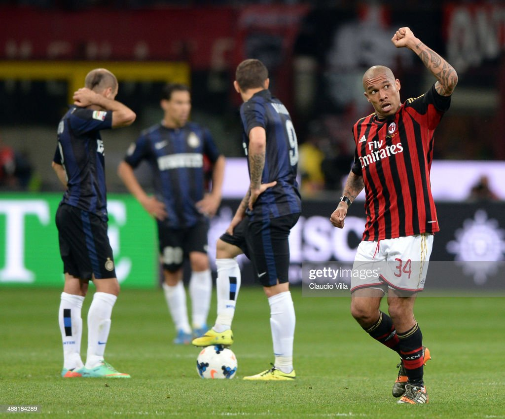<a gi-track='captionPersonalityLinkClicked' href=/galleries/search?phrase=Nigel+de+Jong&family=editorial&specificpeople=579818 ng-click='$event.stopPropagation()'>Nigel de Jong</a> of AC Milan (R) celebrates scoring the first goal during the Serie A match between AC Milan and FC Internazionale Milano at Stadio Giuseppe Meazza on May 4, 2014 in Milan, Italy.