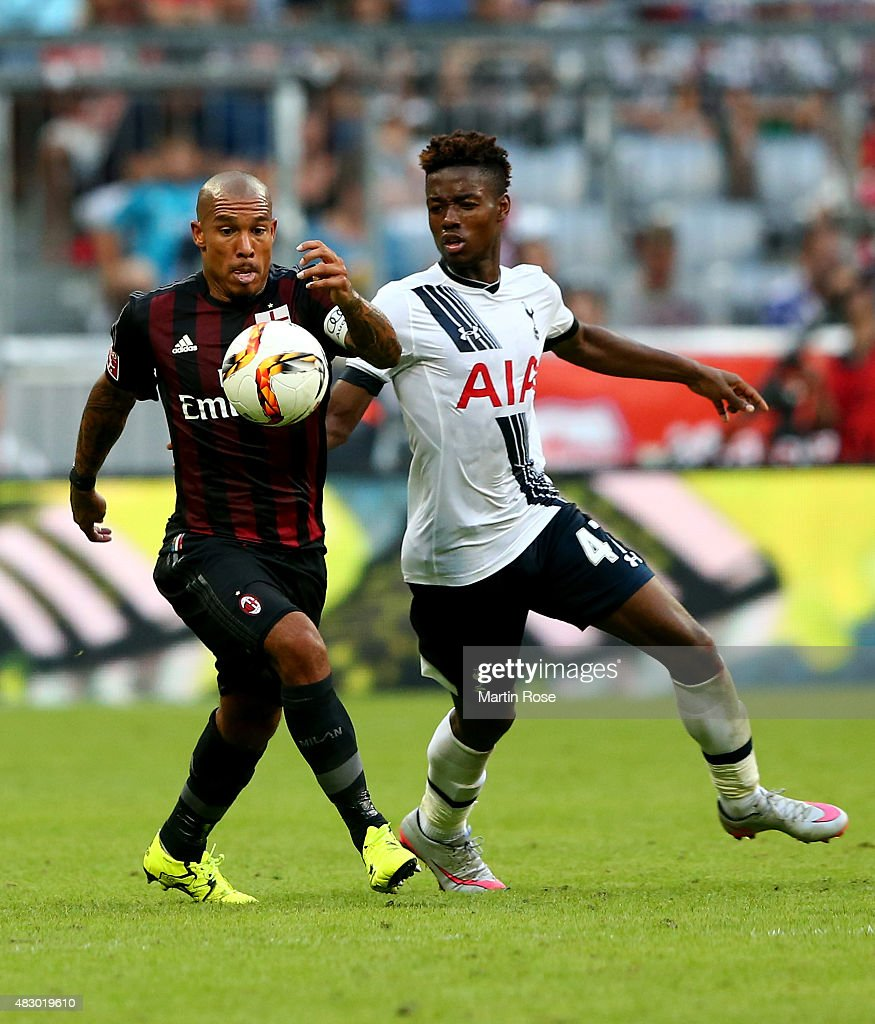 Nigel de Jong (L) of AC Milan is challenged by Josh Onomah of Tottenham Hotspur during the Audi Cup 2015 third place match between AC Milan and Tottenham Hotspur at Allianz Arena on August 5, 2015 in Munich, Germany.