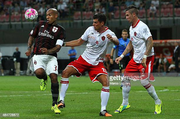 Nigel De Jong of AC Milan is challenged by Marco Rossi and Matteo Ardemagni of AC Perugia during the TIM Cup match between AC Milan and AC Perugia at...